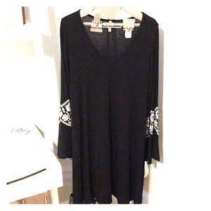 Black maternity dress. Bell sleeves. Floral detail